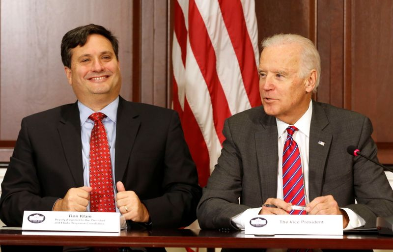 FILE PHOTO: U.S. Vice President Joe Biden is joined by Ebola Response Coordinator Ron Klain (L) in the Eisenhower Executive Office Building on the White House complex in Washington