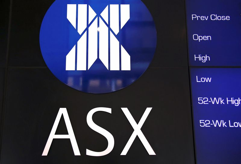 A board displaying stock prices is adorned with the Australian Securities Exchange (ASX) logo in central Sydney