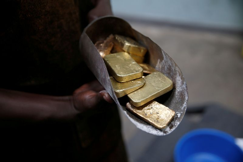 FILE PHOTO: An employee holds gold bars before the refining process at AGR (African Gold Refinery) in Entebbe