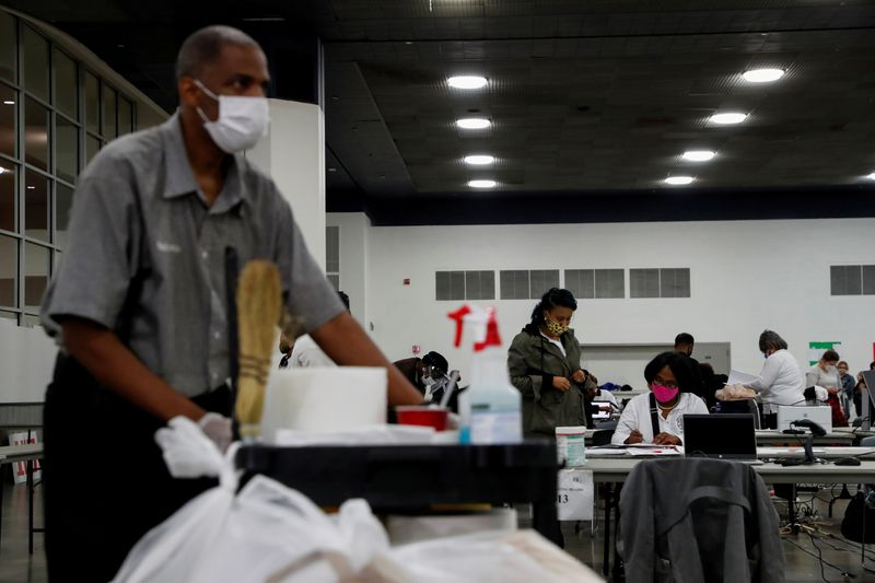 FILE PHOTO: Votes continue to be counted at the TCF Center the day after the 2020 U.S. presidential election, in Detroit, Michigan
