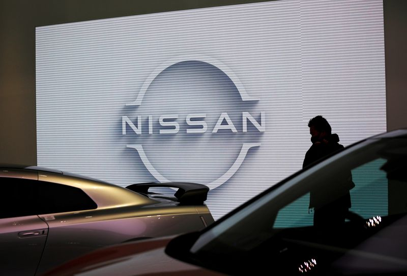 FILE PHOTO: A visitor is seen at a Nissan Motor showroom in Tokyo