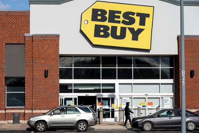 FILE PHOTO: People wait for purchases outside of a Best Buy store due to the outbreak of coronavirus in Arlington, Virginia