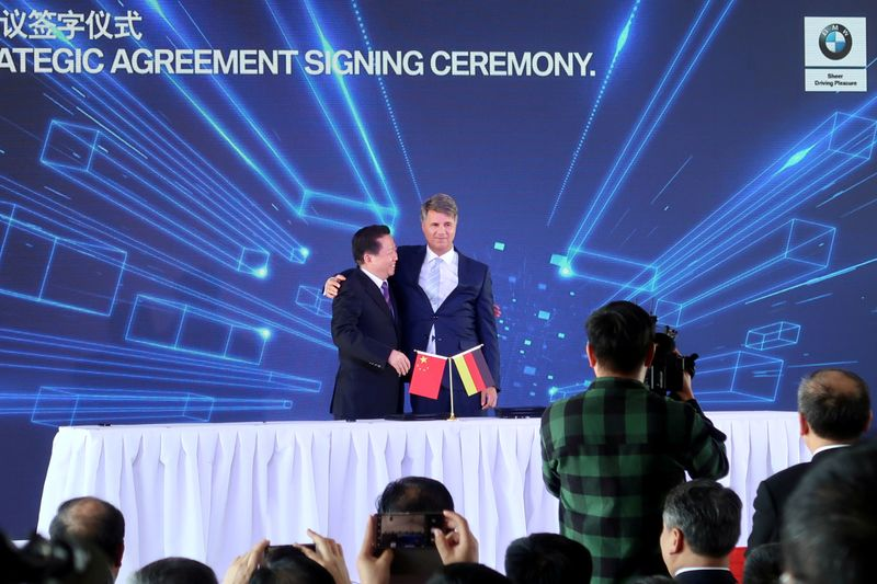 FILE PHOTO: Harald Krueger, BMW Chief Executive hugs Chen Qiufa, Communist Party Secretary of Liaoning province for a photo during a signing ceremony inside the BMW Brilliance Plant Tiexi, in Shenyang